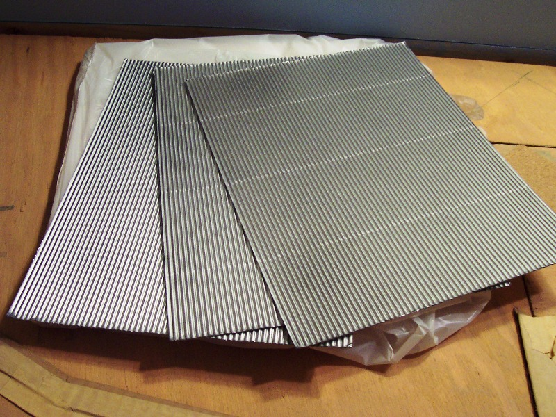 Black corrugated card stock painted metal silver